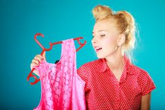 Pinup girl buying clothes pink dress. Sale retail. Royalty Free Stock Images