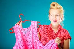 Pinup girl buying clothes pink dress. Sale retail. Stock Photography