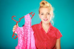 Pinup girl buying clothes pink dress. Sale retail. Royalty Free Stock Photos