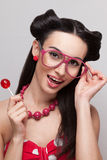 Pinup girl with candy Royalty Free Stock Photography