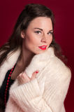 Pinup Girl in Creamy Fur Coat Stock Photos