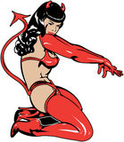 Pinup girl in devil costume Stock Photos