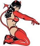 Pinup girl in devil costume stock photos