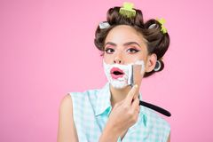 Pinup girl with fashion hair. pin up woman with makeup. morning grooming and skincare. retro woman shaving with foam and. Razor blade. pretty girl in vintage royalty free stock photo