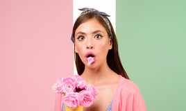 Pinup girl with fashion hair. pin up woman with trendy makeup. flower bouquet. Florist. Summer. retro woman eating ice. Cream from flowers. pretty girl in royalty free stock photos