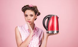 Pinup girl with fashion hair. pretty girl in vintage style. pin up woman with trendy makeup. perfect housewife. retro. Woman cooking in kitchen. Enjoying her stock image