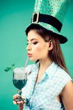 Pinup girl with fashion hair. retro woman drink summer cocktail. pin up woman with trendy makeup. pretty girl in vintage. Style. St. Patricks Day. elf or stock photo