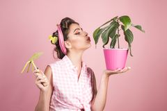 Pinup girl with fashion hair. spring. pin up woman with trendy makeup. greenhouse worker or gardener. retro woman. Growing plants. Garden. pretty girl in royalty free stock image