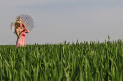 Pinup girl in the field Stock Photos