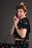 Pinup Girl in Flowered Grins with Phone Royalty Free Stock Photos