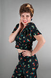 Pinup Girl in Flowered Outfit Cheeky Grin Royalty Free Stock Image