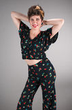 Pinup Girl in Flowered Outfit Flirts Royalty Free Stock Image
