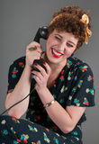 Pinup Girl in Flowered Outfit Laughs While on the Telephone Stock Photos