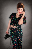 Pinup Girl in Flowered Outfit On Phone Stock Photos