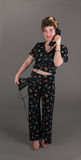 Pinup Girl in Flowered Outfit with Phone Royalty Free Stock Photo