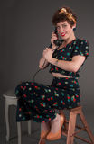 Pinup Girl in Flowered Outfit on The Phone Stock Photography