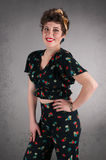 Pinup Girl in Flowered Outfit Poses Stock Images