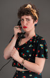 Pinup Girl in Flowered Outfit Pouts on the Phone Royalty Free Stock Photo