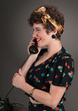 Pinup Girl in Flowered Outfit Profile on Phone Royalty Free Stock Photo