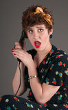 Pinup Girl in Flowered Outfit Shocked by Information Received Stock Photography