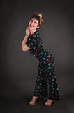 Pinup Girl in Flowered Outfit Stands Against Grey Background Royalty Free Stock Photos