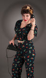 Pinup Girl in Flowered Outfit Talks on Phone Royalty Free Stock Photos