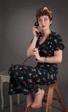 Pinup Girl in Flowered Outfit Waits on the Line Royalty Free Stock Photography