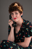 Pinup Girl Frustrated on Old Fashioned Telephone. Grey background Stock Photos