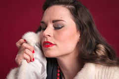 Pinup Girl in Fur Coat Stock Photography