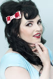 Pinup Girl with Hair Bow Royalty Free Stock Image