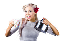 Pinup girl holding kettle and mug Royalty Free Stock Photo