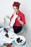 Pinup girl ironing accident Stock Photo