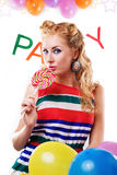 Pinup girl with lollipop, baloons and party word Stock Photography