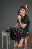 Pinup Girl Looks Exasperated While on Old Phone. Pinup Girl Looks Exasperated While on Old-Fashioned Telephone royalty free stock image