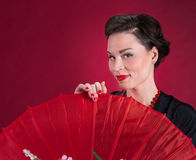 Pinup Girl Looks Over Red Parasol Stock Photos