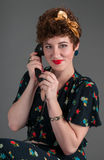 Pinup Girl on Old Fashioned Telephone Smiles Stock Photos