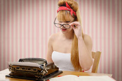 Pinup girl with old typewriter Stock Photography