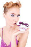 Pinup girl with perfume Stock Photos