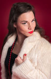 Pinup Girl Poses in Creamy Fur Coat Royalty Free Stock Image