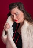 Pinup Girl Poses in Fur Coat Royalty Free Stock Photos