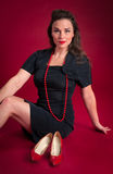 Pinup Girl Poses with Vintage Red Shoes Royalty Free Stock Image