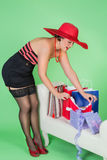 Pinup girl with present. Elegant pin up girl unwrapping a sexy present Royalty Free Stock Photography