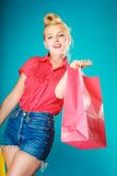 Pinup girl with shopping bag buying clothes. Sale Royalty Free Stock Images