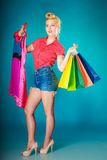 Pinup girl with shopping bags buying clothes dress Royalty Free Stock Image