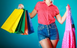 Pinup girl with shopping bags buying clothes dress Royalty Free Stock Photo