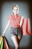Pinup girl with shopping bags buying clothes. Sale Royalty Free Stock Photo