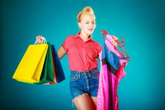 Pinup girl with shopping bags buying dress. Sale Royalty Free Stock Image