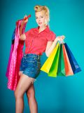 Pinup girl with shopping bags buying dress. Sale Royalty Free Stock Photography