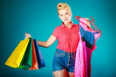 Pinup girl with shopping bags buying dress. Sale Stock Photo