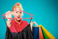Pinup girl with shopping bags buying skirt. Sale Stock Photos